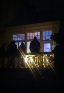 Some of the people who stopped to give their attention to the shadow piece